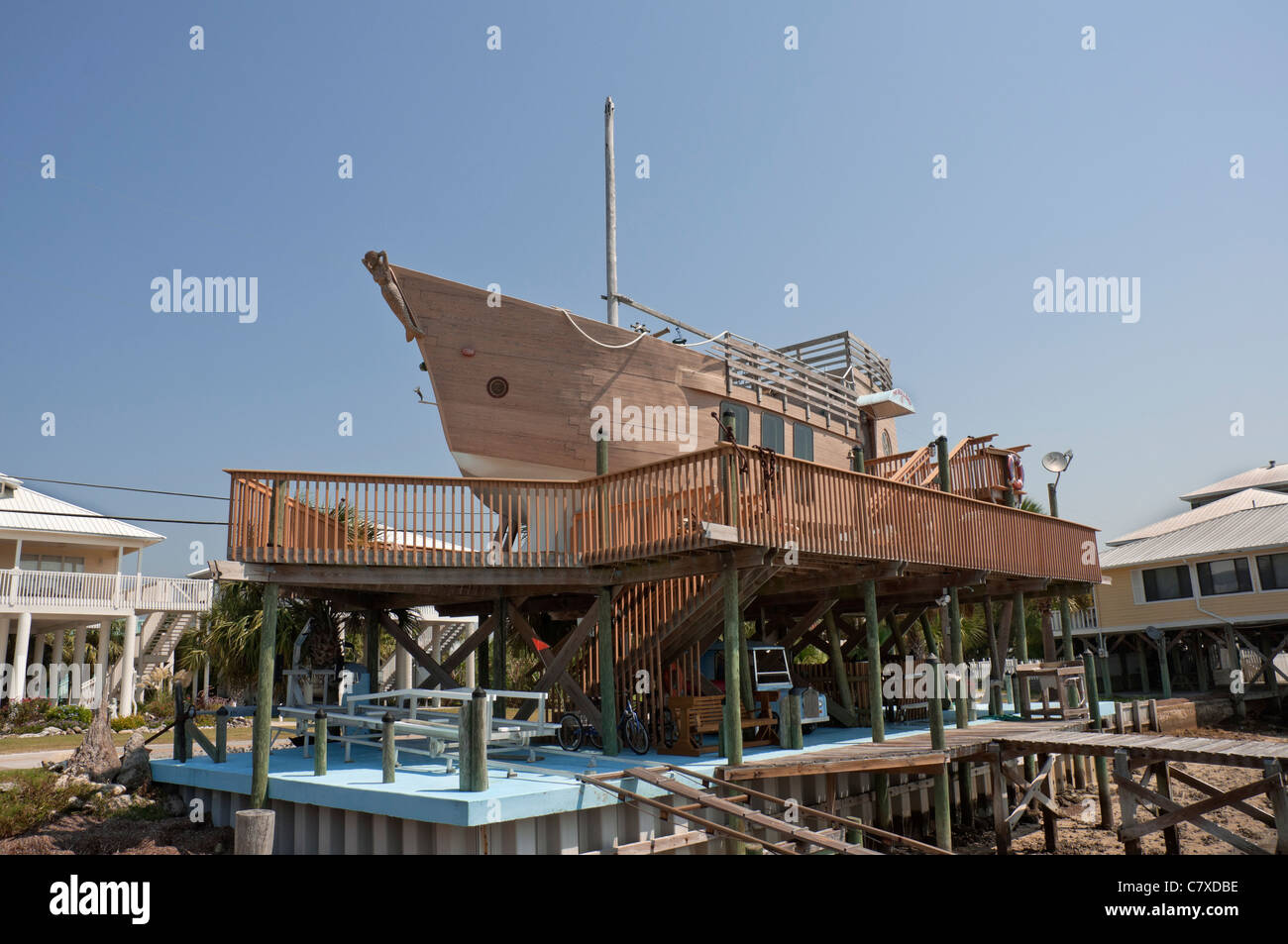 Beach cottage shaped like a boat sits atop pilings in the funky little town of Horseshoe Beach along Florida's - Stock Image