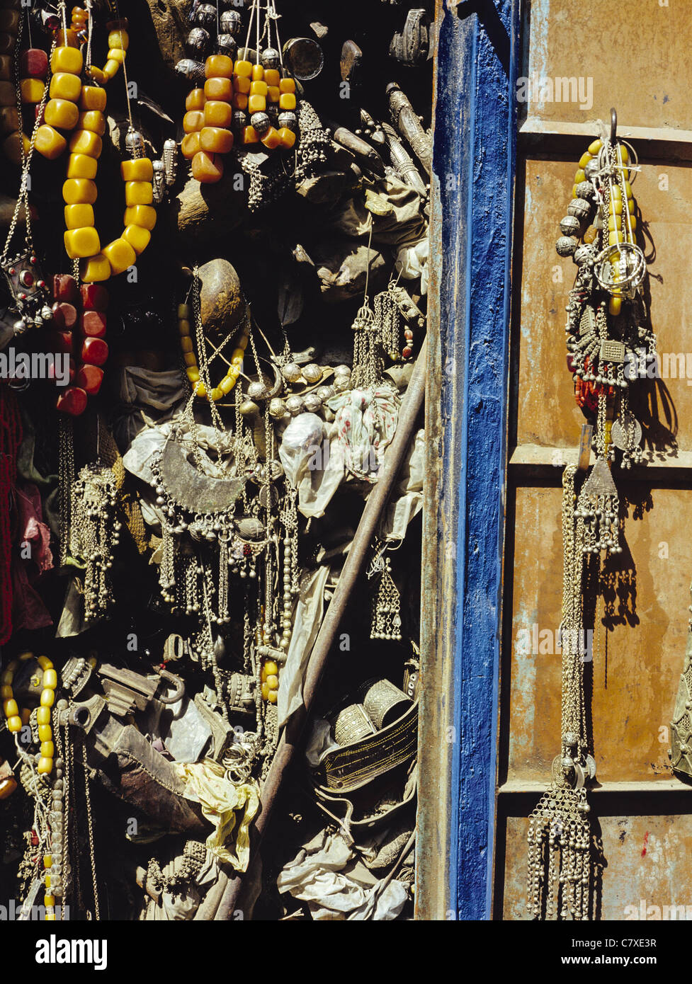 Jewelry display with necklaces made of silver and amber in the Suq-al-Milh marketplace in Sana'a, Yemen - Stock Image