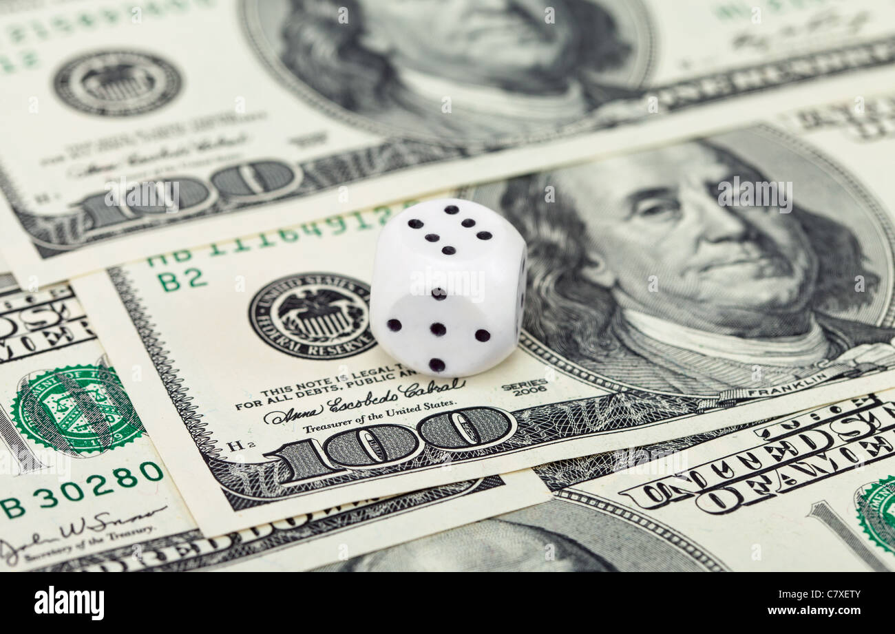 Dices on money background - business concept - Stock Image