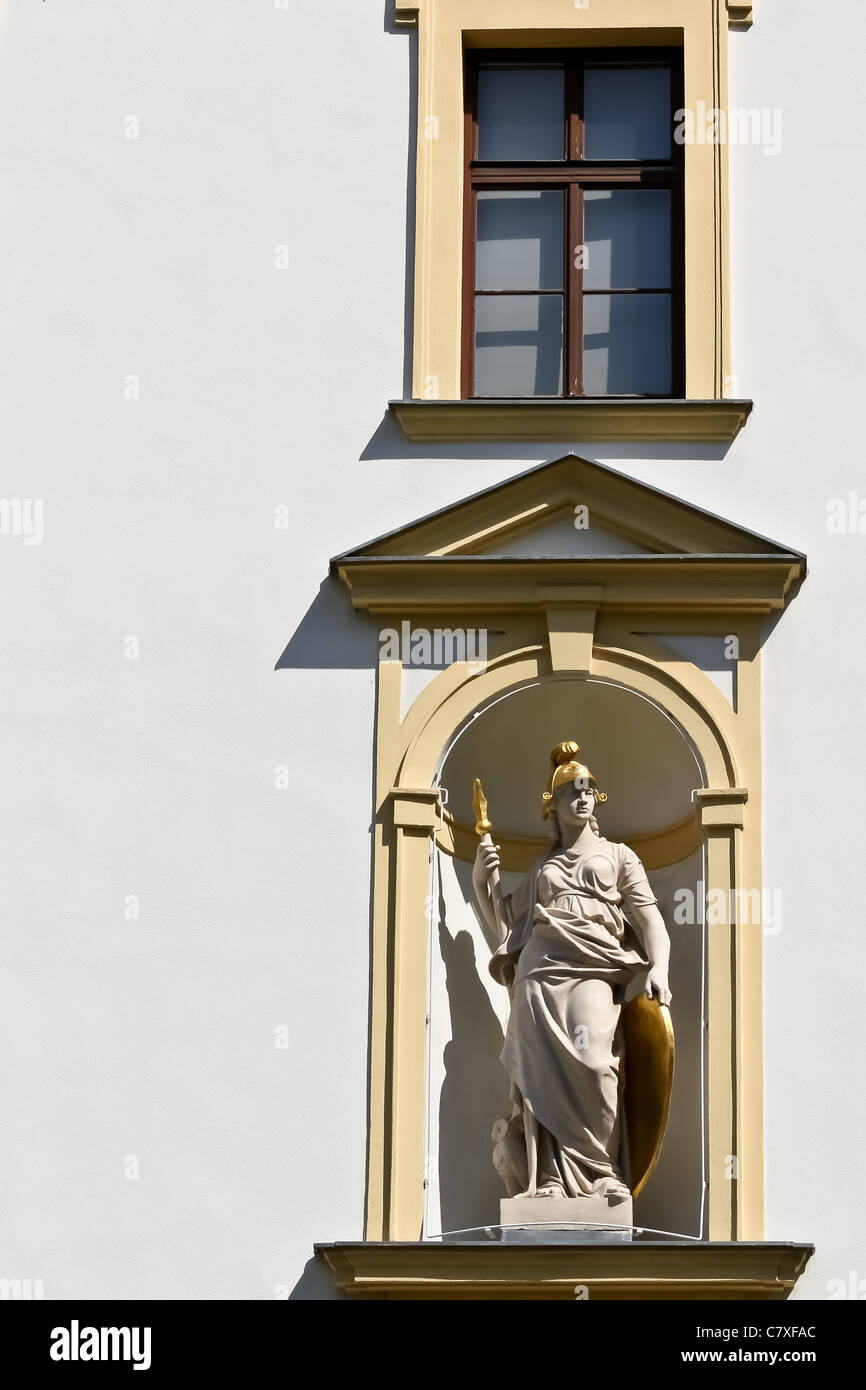 A female warrior in a facade of a public building in Vienna - Stock Image