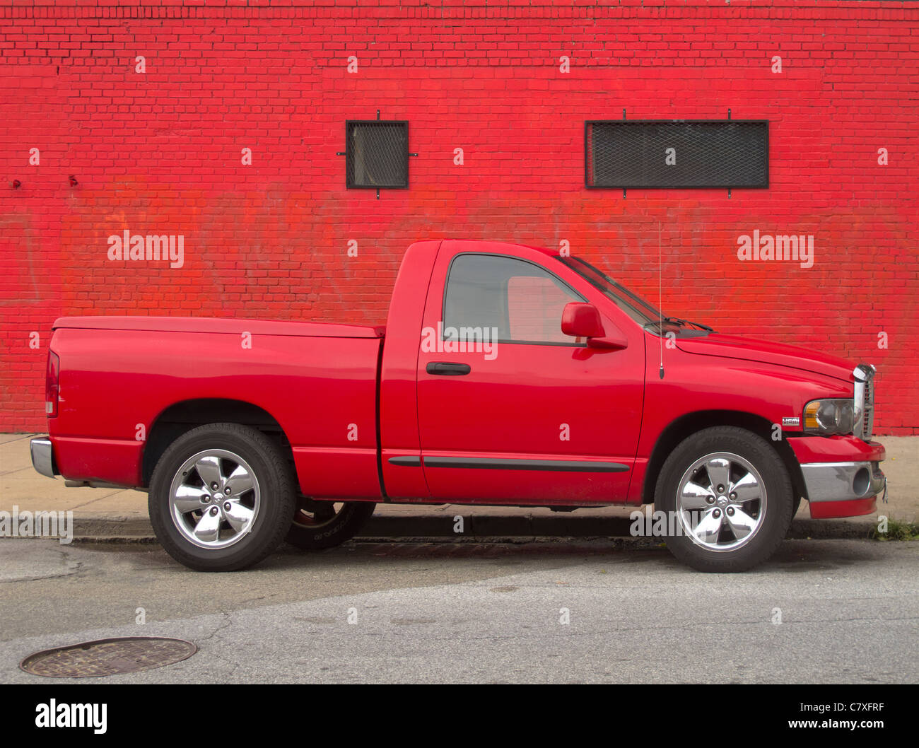 red monochromatic truck and wall - Stock Image