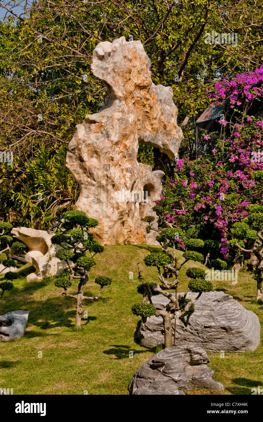 Unusual Rock Formation and Topiary - Stock Image