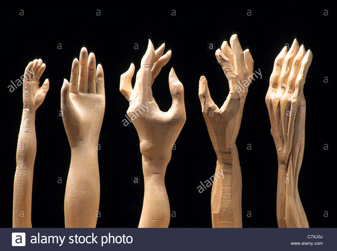 Five wooden carved hands - Stock Image