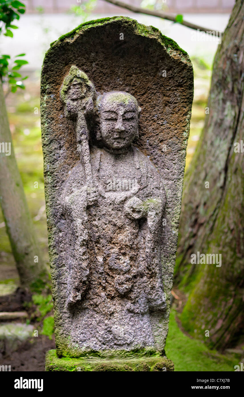 Old Weathered Stone Statue Of Jizo, Japanese Buddhist / Shinto Guardian Of  Children, In An Old Garden In Japan. Buddhism; Deity; Religious Statue