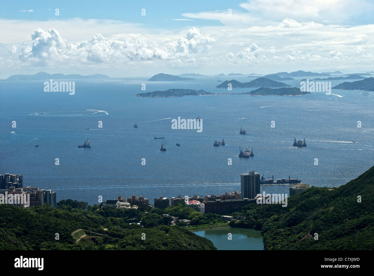 A view above Pok Fu Lam country park and Pok Fu Lam reservoir with the West Lamma Channel and various out-lying - Stock Image