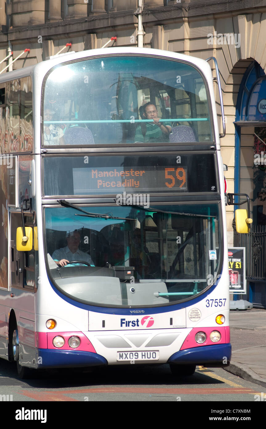 Double decker First bus in city centre Manchester. - Stock Image