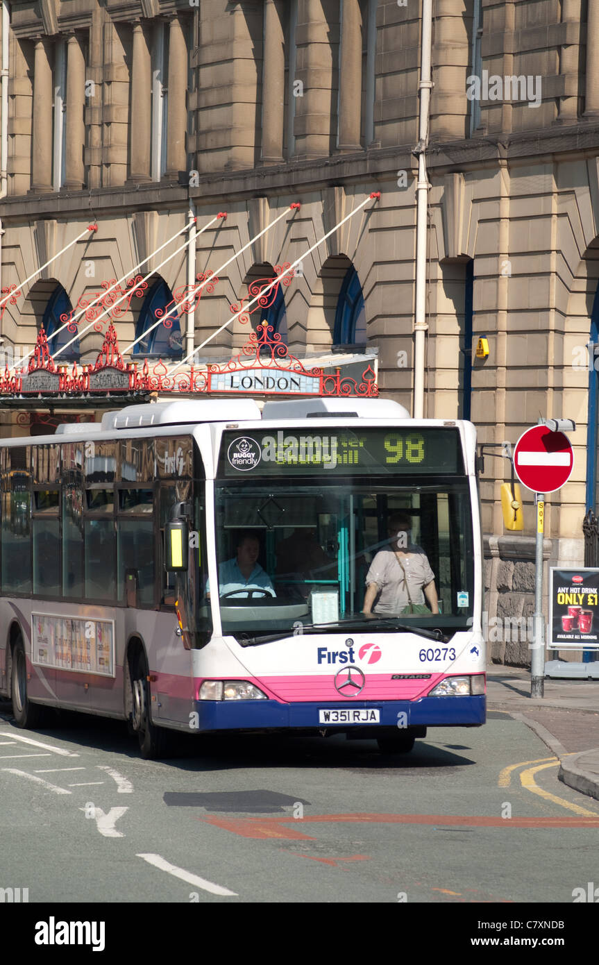 Single decker First bus in city centre Manchester. - Stock Image