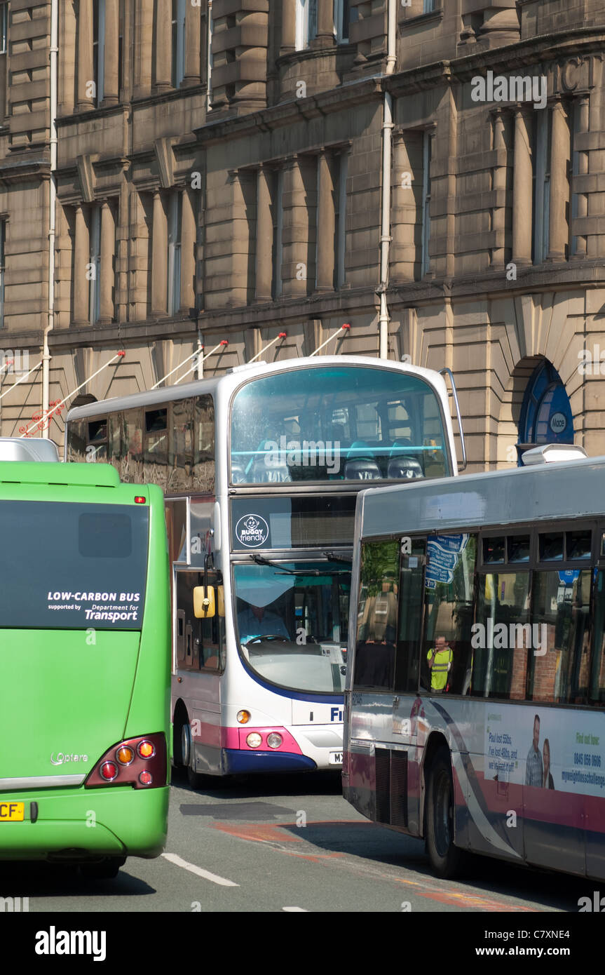 Buses in city centre Manchester. - Stock Image