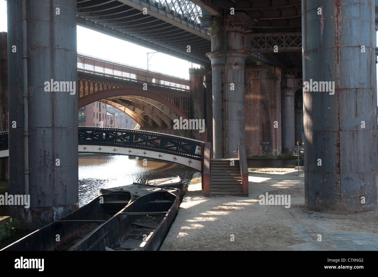 Industrial heritage, bridges over the canal system in the Castlefield district of Manchester,UK. - Stock Image