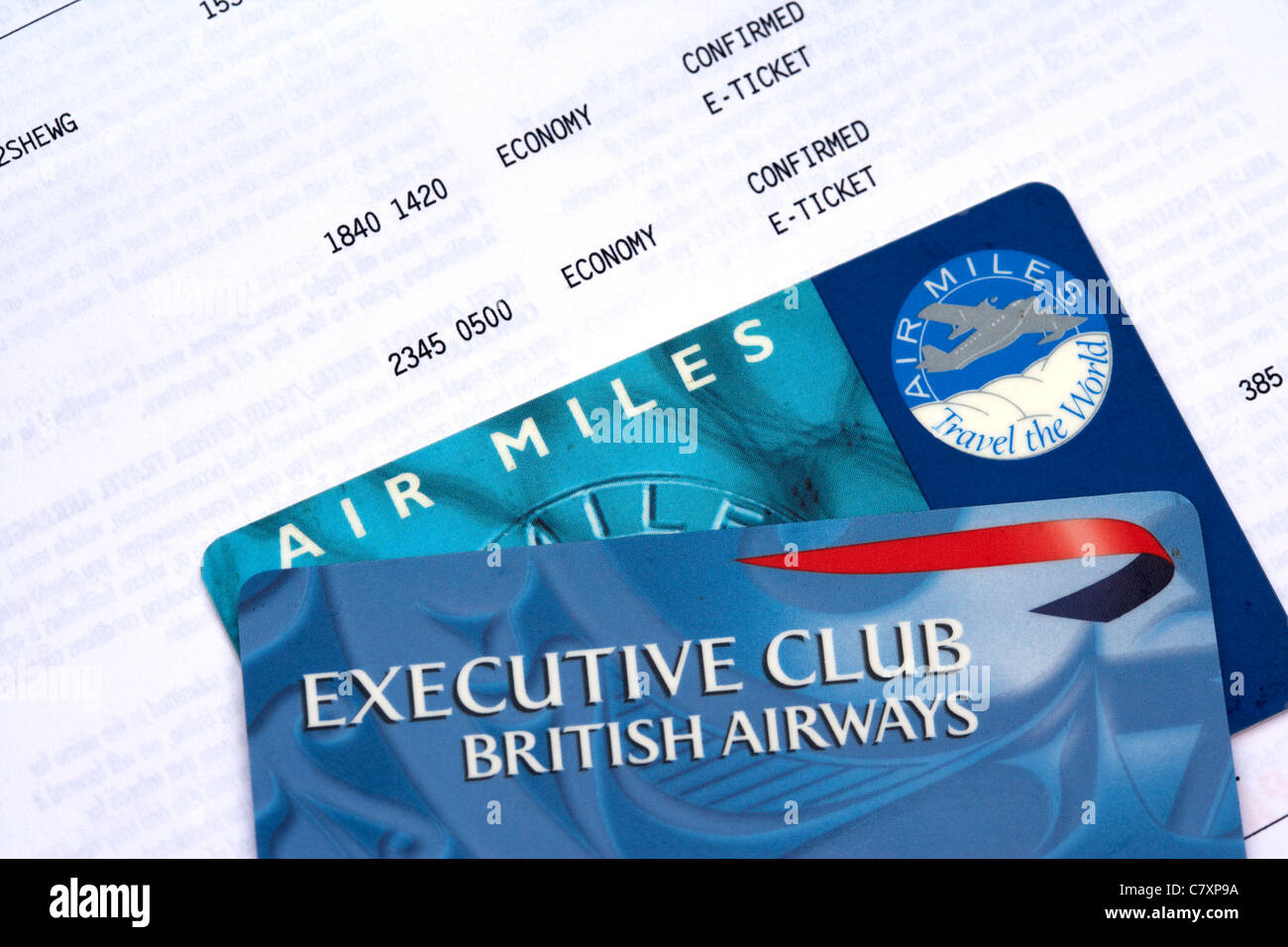 british airways executive club card airmiles card and e-ticket BA flight confirmation rebranded as avios and now - Stock Image
