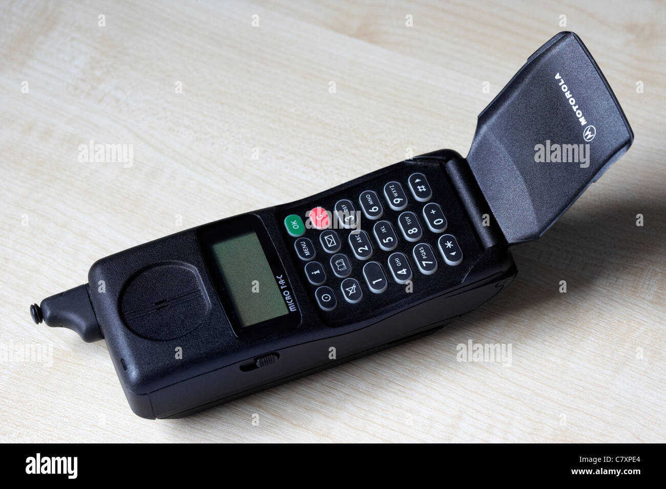 flip open on a motorola micro tac international 7500 gsm 900 mobile phone from the mid nineties - Stock Image