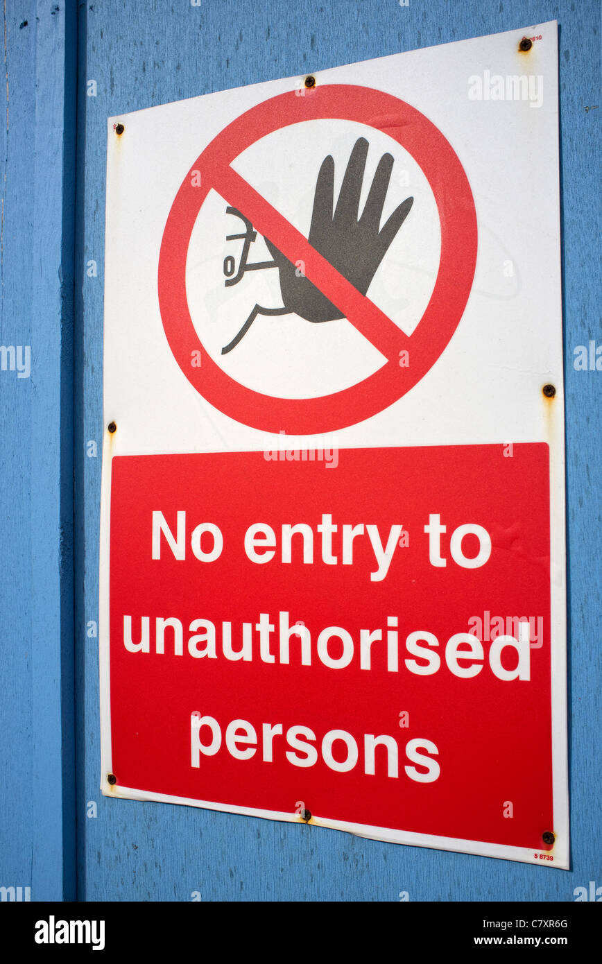 No entry to unauthorised persons sign on a door - Stock Image