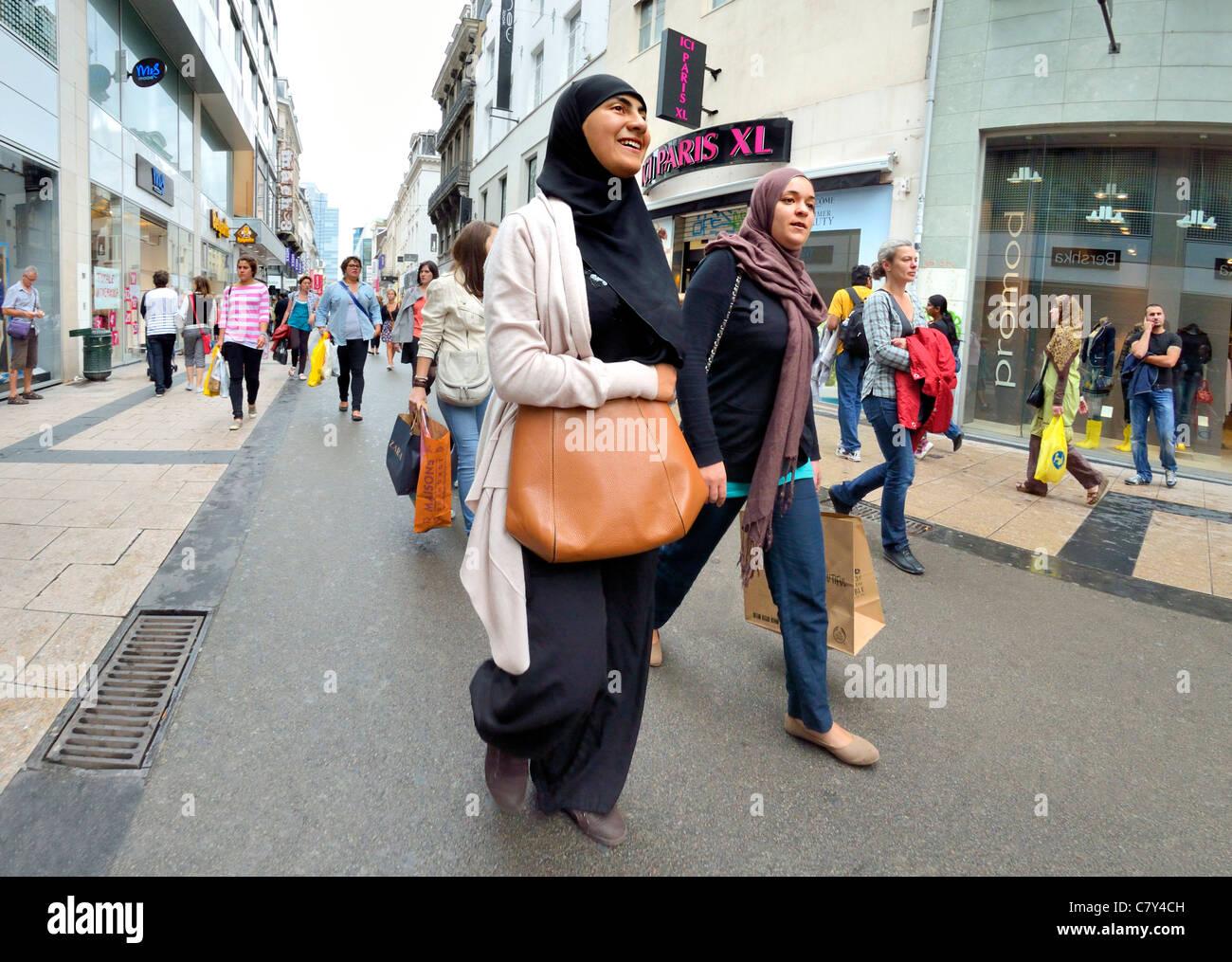 Brussels, Belgium. Two women in headscarves walking down shopping street - Stock Image