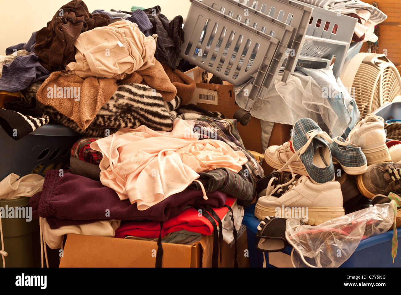 Pile of misc items stored in an unorganized fashion in a room - Stock Image