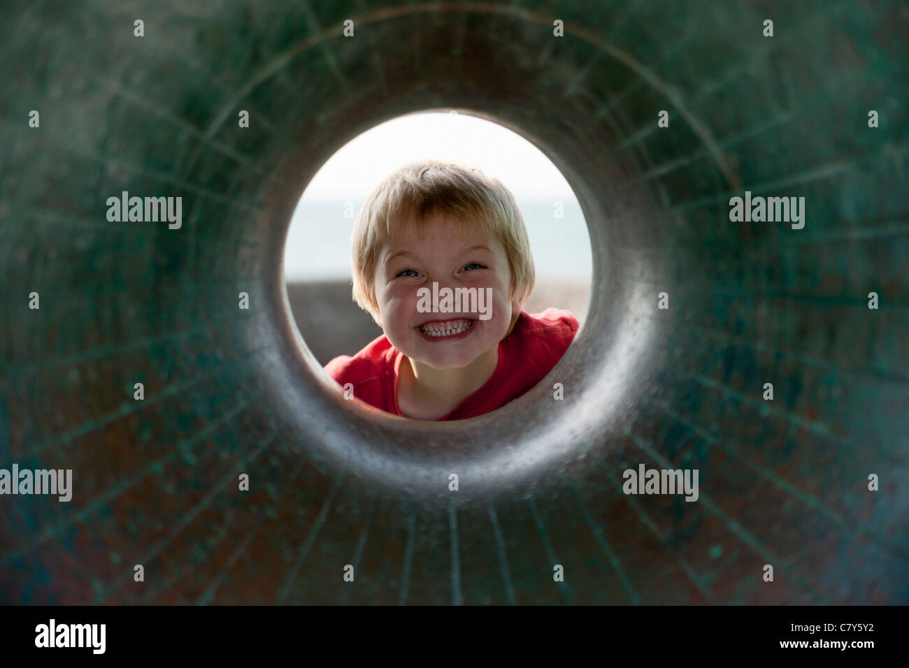 blond haired boy with a big smiley face - Stock Image