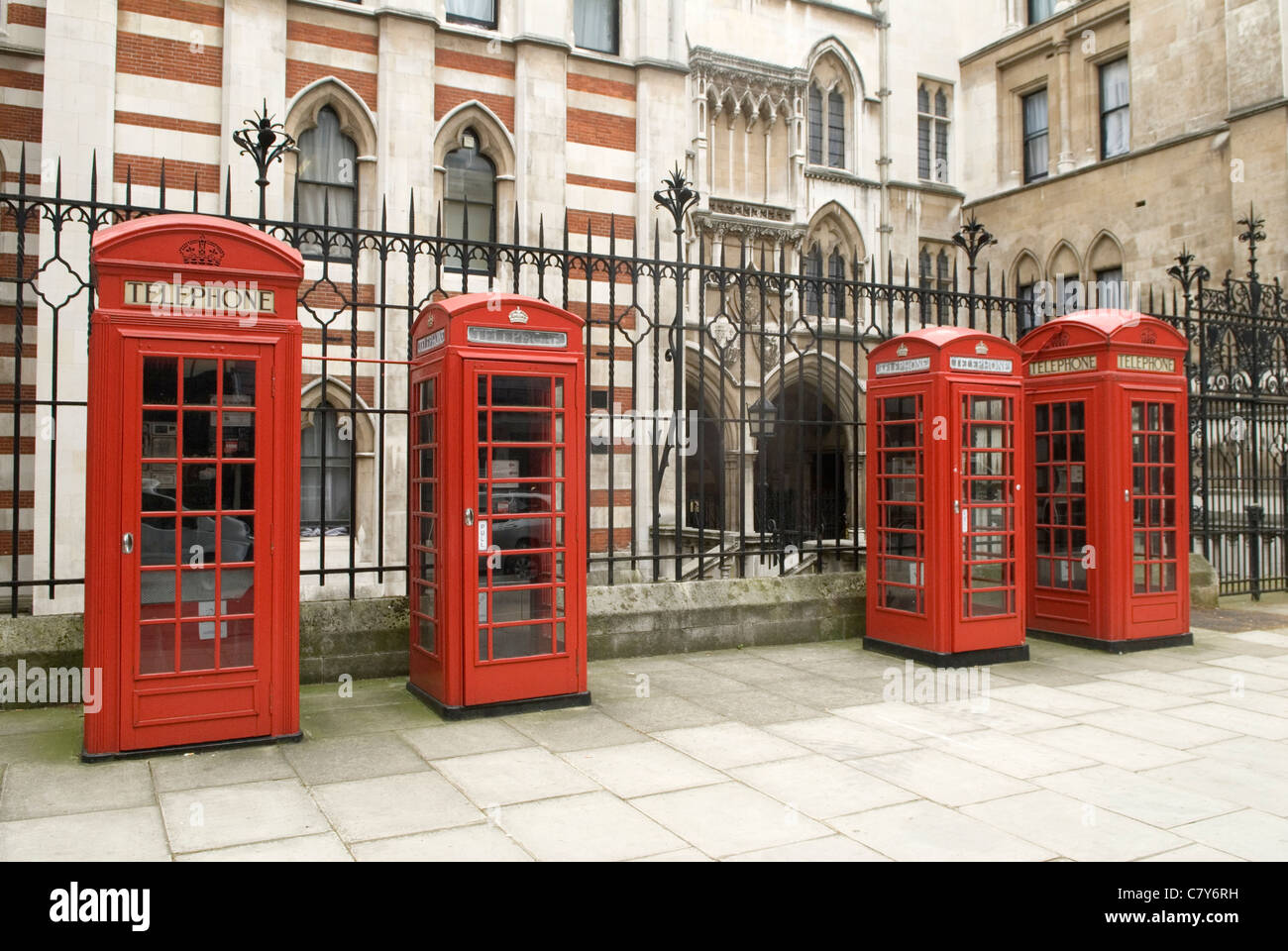 Red British telephone boxes Carey street London UK Large and small Sir Giles Gilbert Scott design. - Stock Image