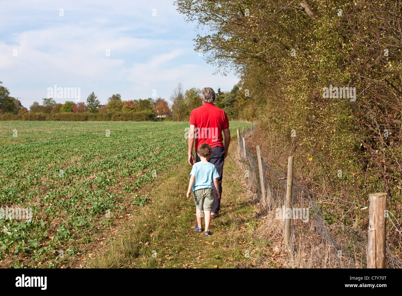 A grandad and grandson walking in the English countryside in the early October heatwave, 2011 - Stock Image