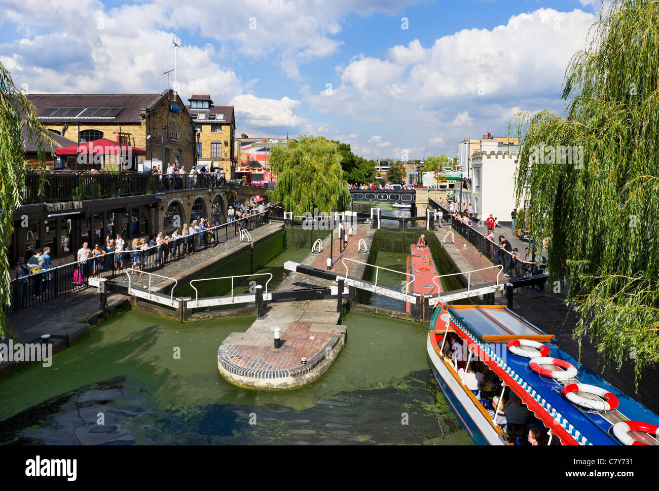 Narrowboat tour at Camden Lock on the Regent's Canal, North London, England, UK - Stock Image