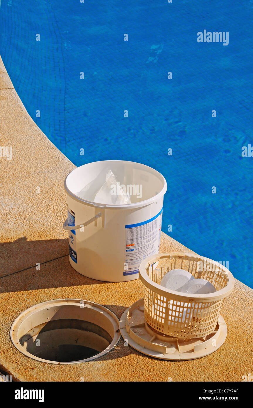 Pool chlorine tablets in basket and tub at poolside, Calahonda, Mijas Costa, Costa del Sol, Andalucia, Spain, Western Stock Photo