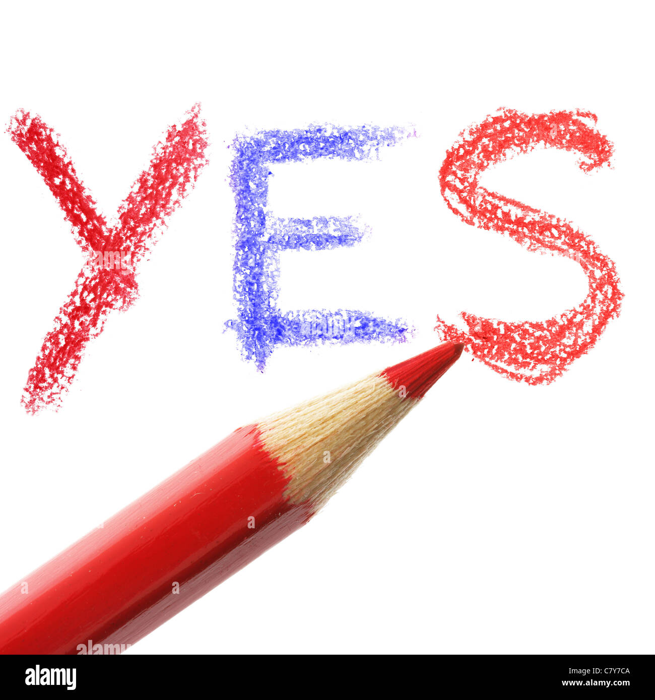 Crayon writing word YES over white background - Stock Image