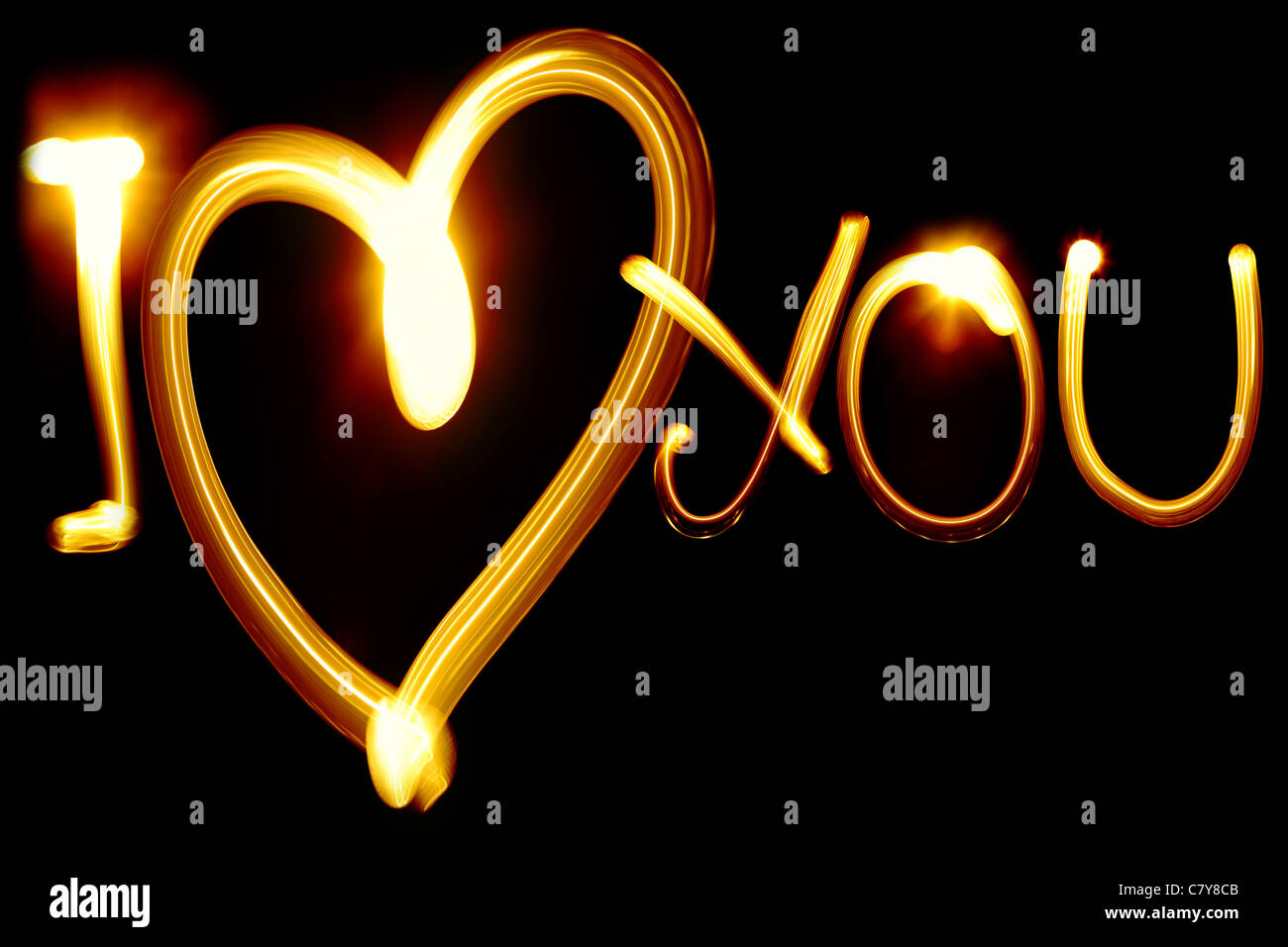 I LOVE YOU phrase created by light over black background - Stock Image