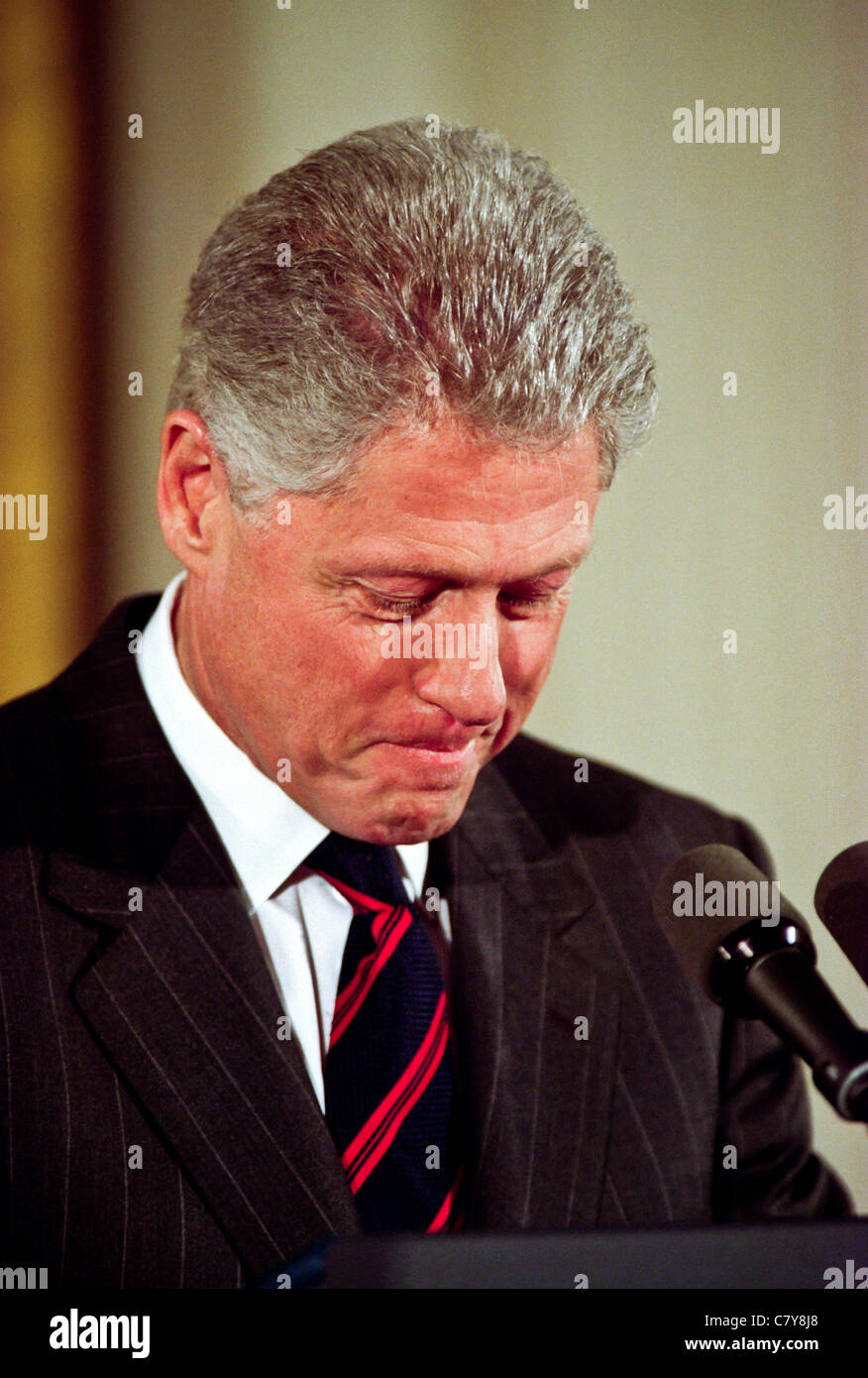 President Bill Clinton pauses during an event in the East Room of the White House January 13, 1999 - Stock Image