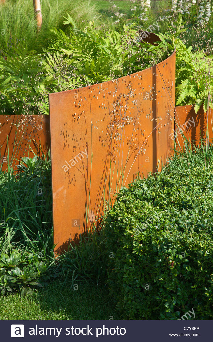 contemporary garden with curved rusted corten steel panel digitalis stock photo 39322942 alamy. Black Bedroom Furniture Sets. Home Design Ideas