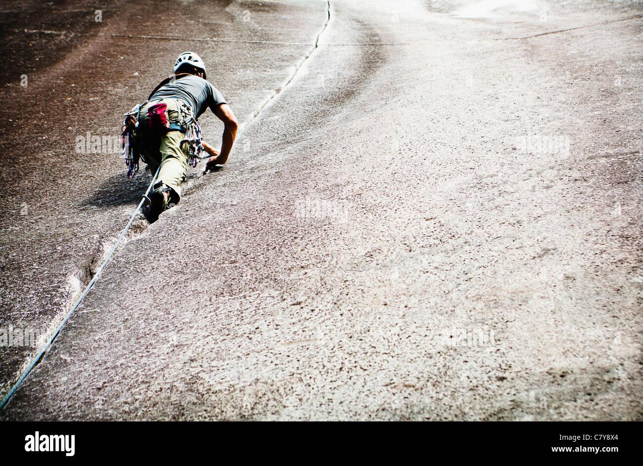 A man climbing Klahanie Crack (5.7) at Squamish BC, Canada. - Stock Image