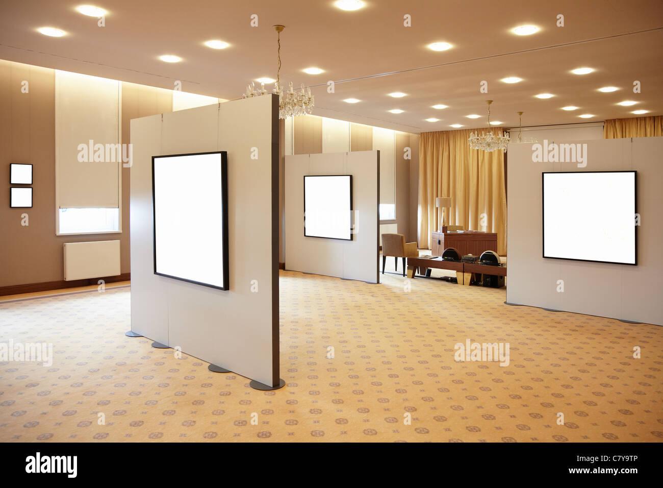 Blank white frames in art gallery interior - Stock Image