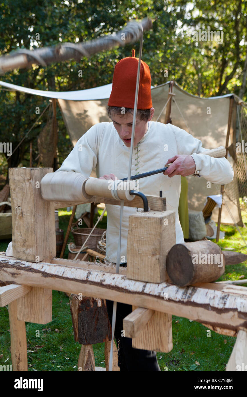 Turning wood on a medieval-style pole lathe. Sherwood Forest Country Park, Edwinstowe, Nottinghamshire, England - Stock Image