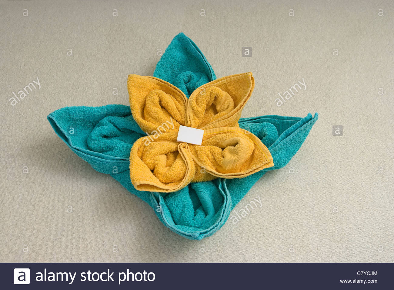 yellow and turquoise towel arrange flower - Stock Image