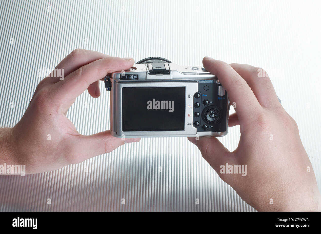 Hands holding a digital camera - Stock Image