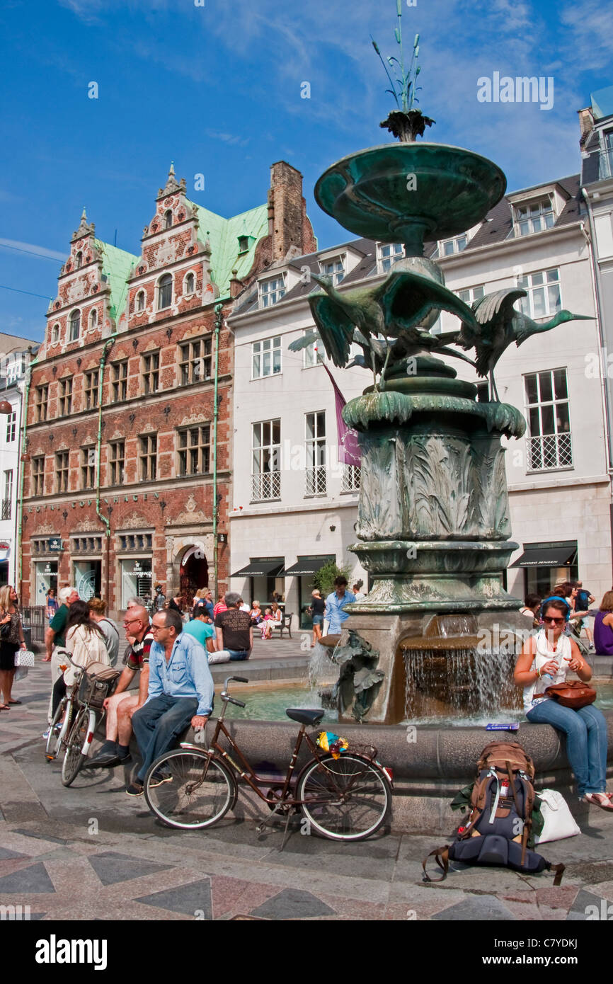 Stork Fountain on Copenhagen's Amagertorv Square is popular meeting place along Stroget pedestrian street - Stock Image