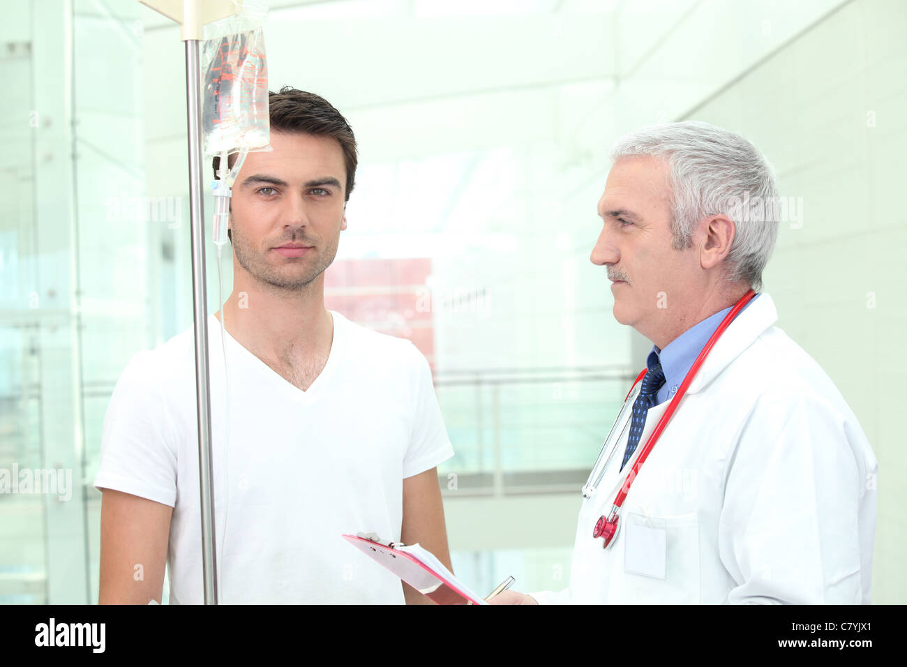 Doctor taking care of a patient - Stock Image