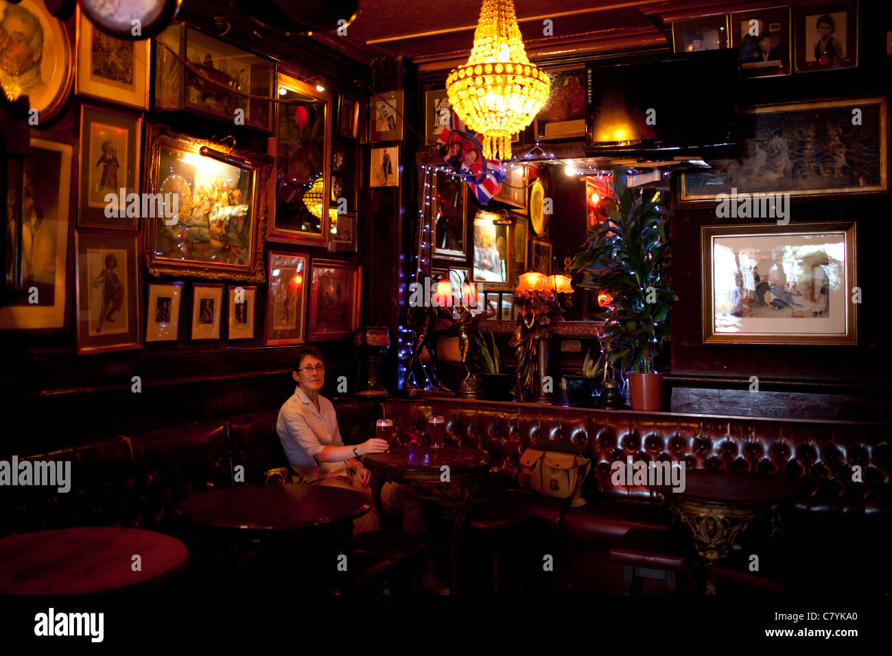 A woman enjoying a drink in the Cross Keys Public House in Covent Garden, London - Stock Image