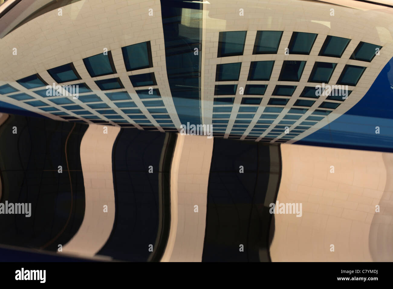 Abstract image of an office building reflected in the window of a car (BMW) in Frankfurt am Main. Stock Photo