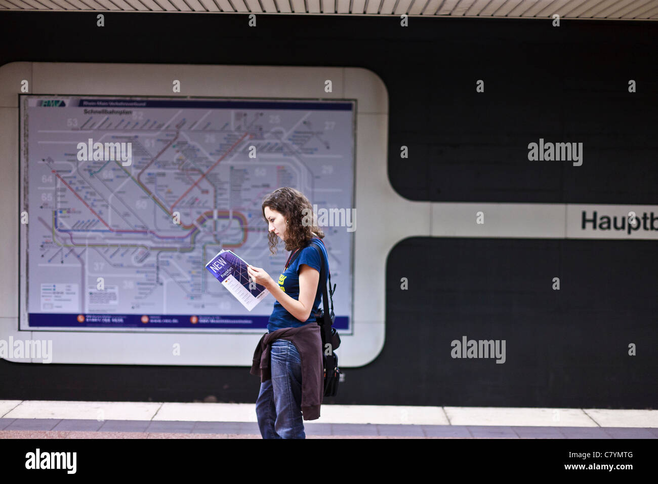 Women reading a travel guide in the main underground station in Frankfurt am Main. Stock Photo