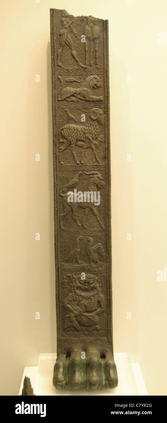 Greek Art. Archaic Age. 6th century BCE. Bronze tripod foot decorated with six reliefs. - Stock Image