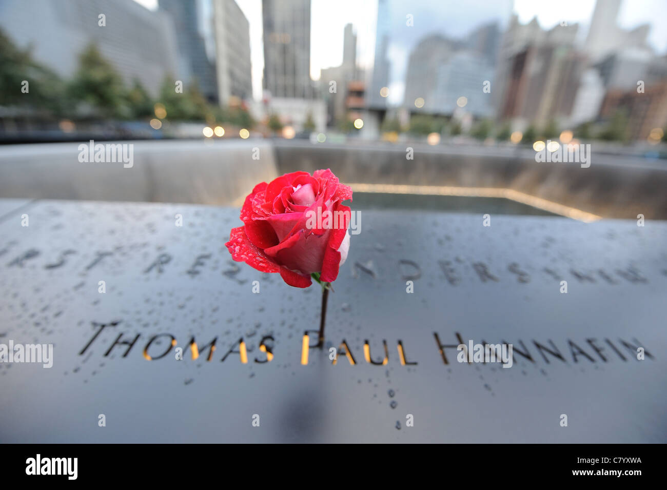 Raindrops beaded on top of the victims' names surrounding the pools at the National September 11 Memorial in - Stock Image
