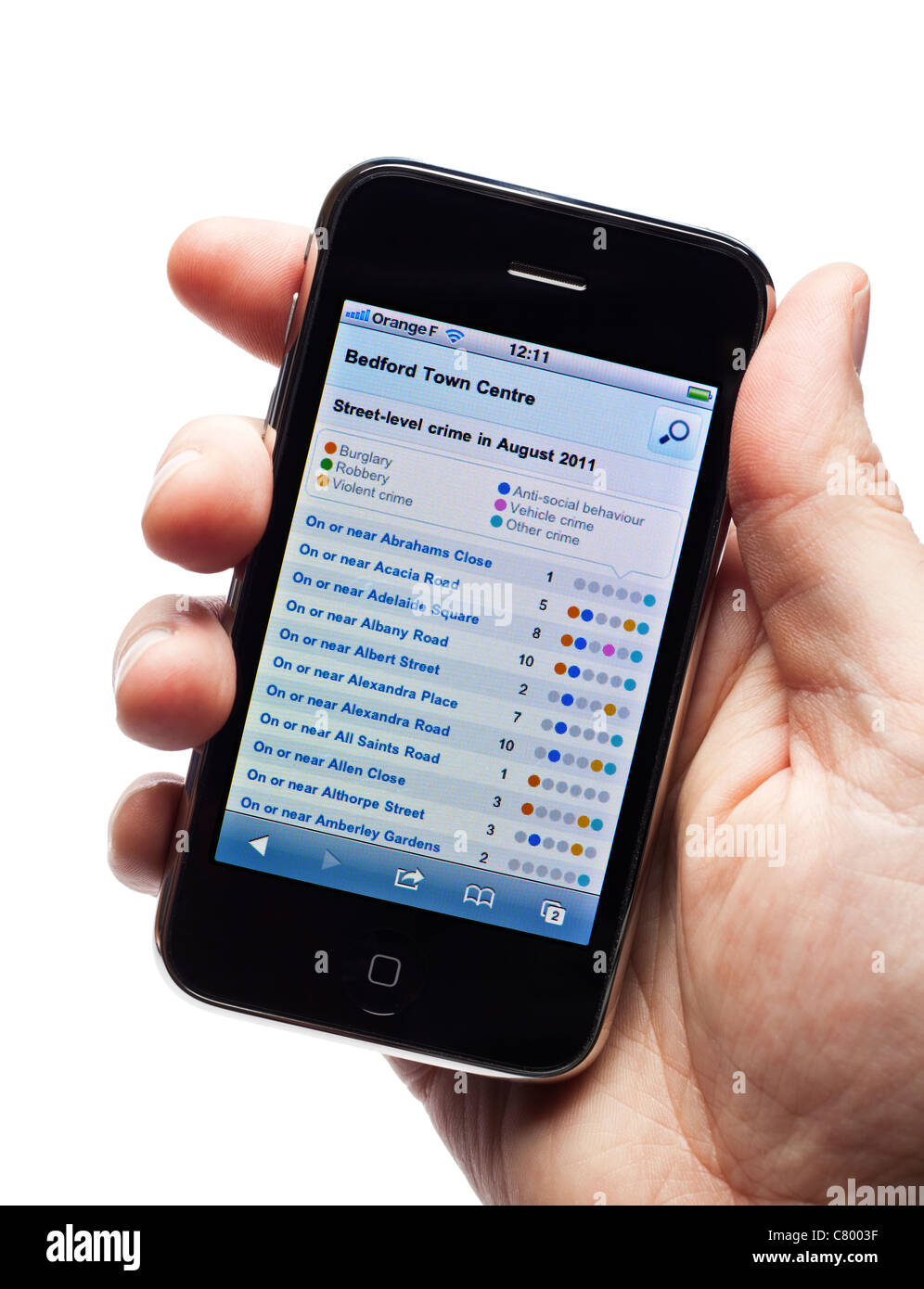 Hand holding iPhone showing the UK Police Crime Map information website - Stock Image