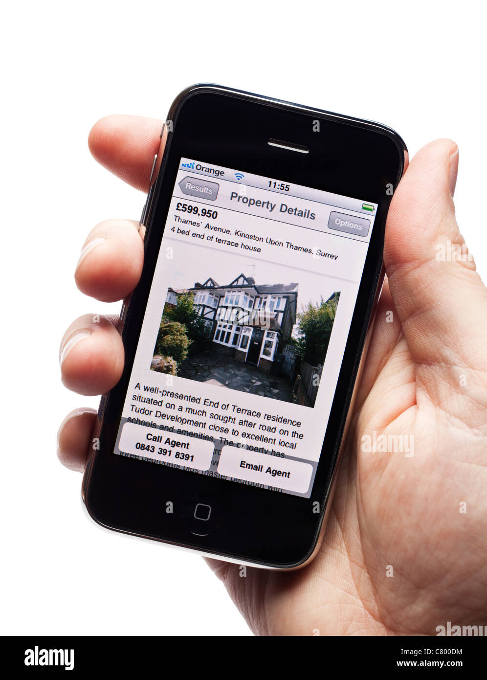 House for sale - Hand holding iPhone smartphone smart phone mobile phone showing property details on the Rightmove - Stock Image