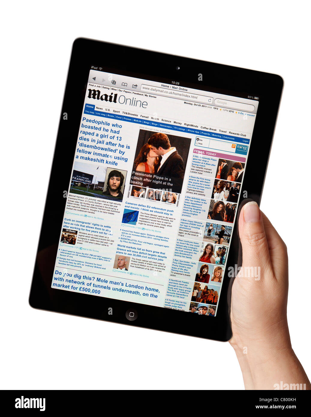 Hand holding iPad showing the Daily Mail newspaper online website - Stock Image