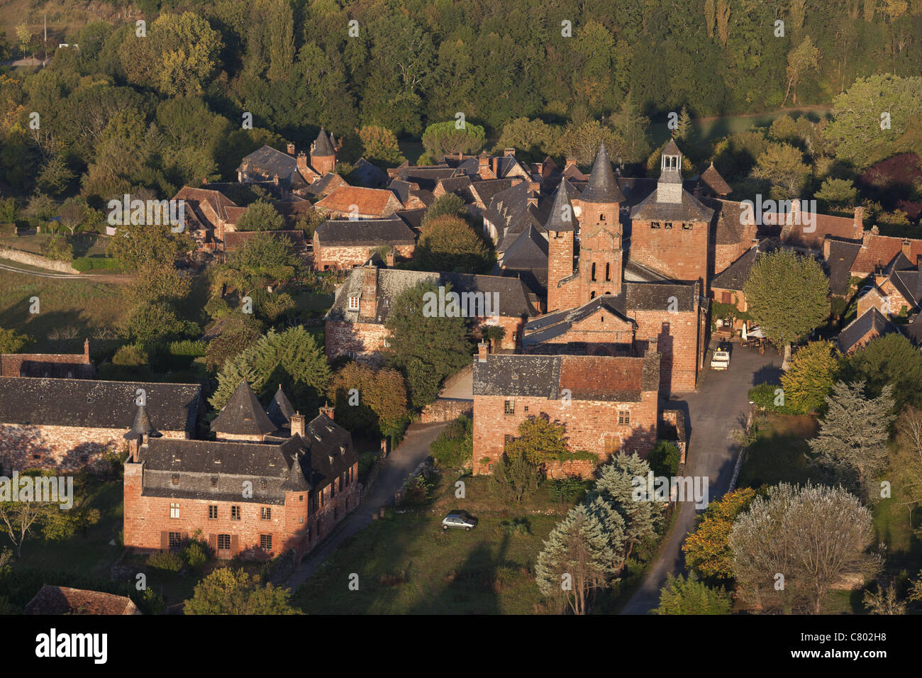 COLLONGES-LA-ROUGE (aerial view). Medieval village with its red sandstone buildings. Corrèze, Limousin region, - Stock Image