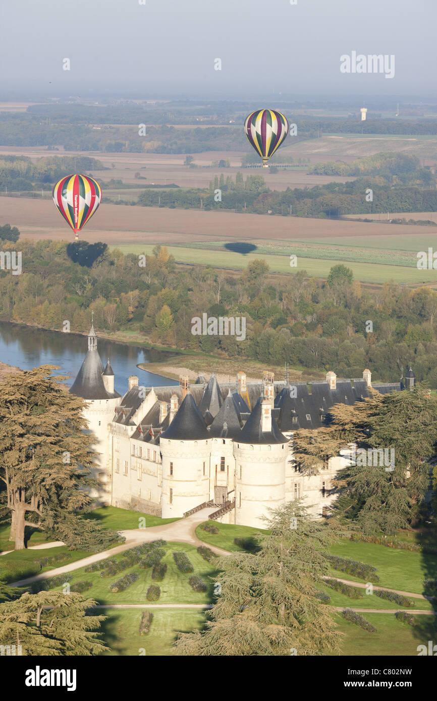 CHAUMONT-SUR-LOIRE CASTLE (aerial view). With the Loire River & 2 hot air balloons behind. Loire Valley, Loir - Stock Image