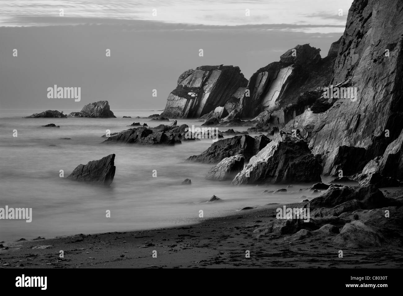 Rocky coast at Ayrmer Cove in the South Hams district of Devon - Stock Image