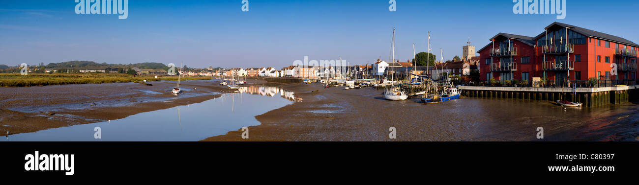 Panoramic photograph at low tide of boats and houses along the River Colne at Wivenhoe near Colchester in Essex. - Stock Image