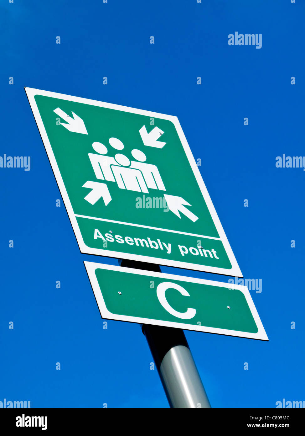 Assembly Point sign to be used in a fire or other emergency in a public place - Stock Image