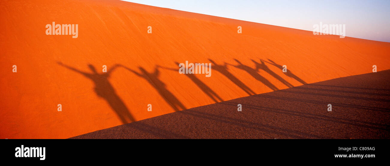 Africa, Chad, people shadows on dune - Stock Image