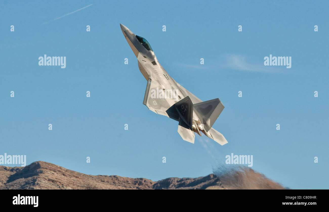 A U.S. Air Force F-22 Raptor takes off from Nellis Air Force Base, Nevada. Stock Photo