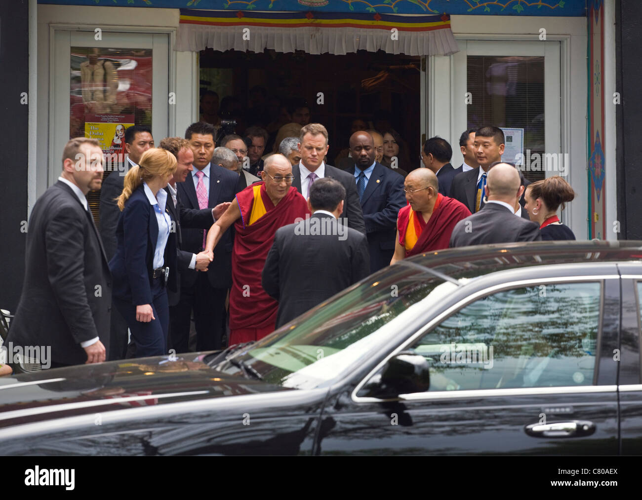 The 14th DALAI LAMA of Tibet and the secret service - BLOOMINGTON, INDIANA Stock Photo